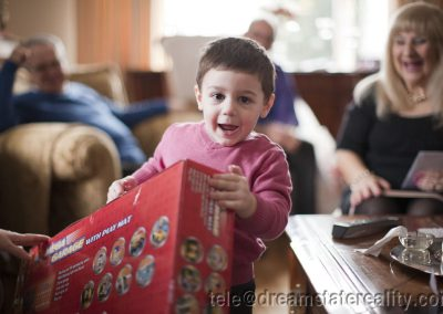 boy_child_xmas_christmas_present_unwrapped_smile